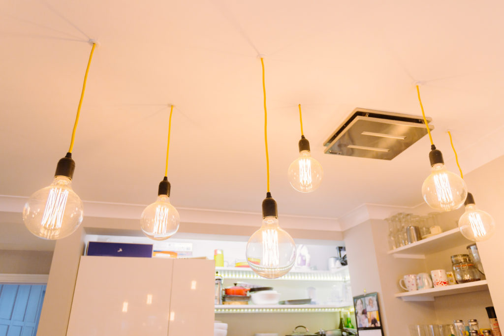 Industrial exposed hanging lightbulbs photographed in Stroud Green North London for Davies & Davies Estate Agents blog