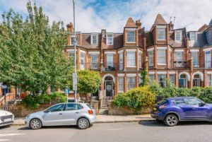 The exterior of a selection of terraced Victorian period property houses in North London.