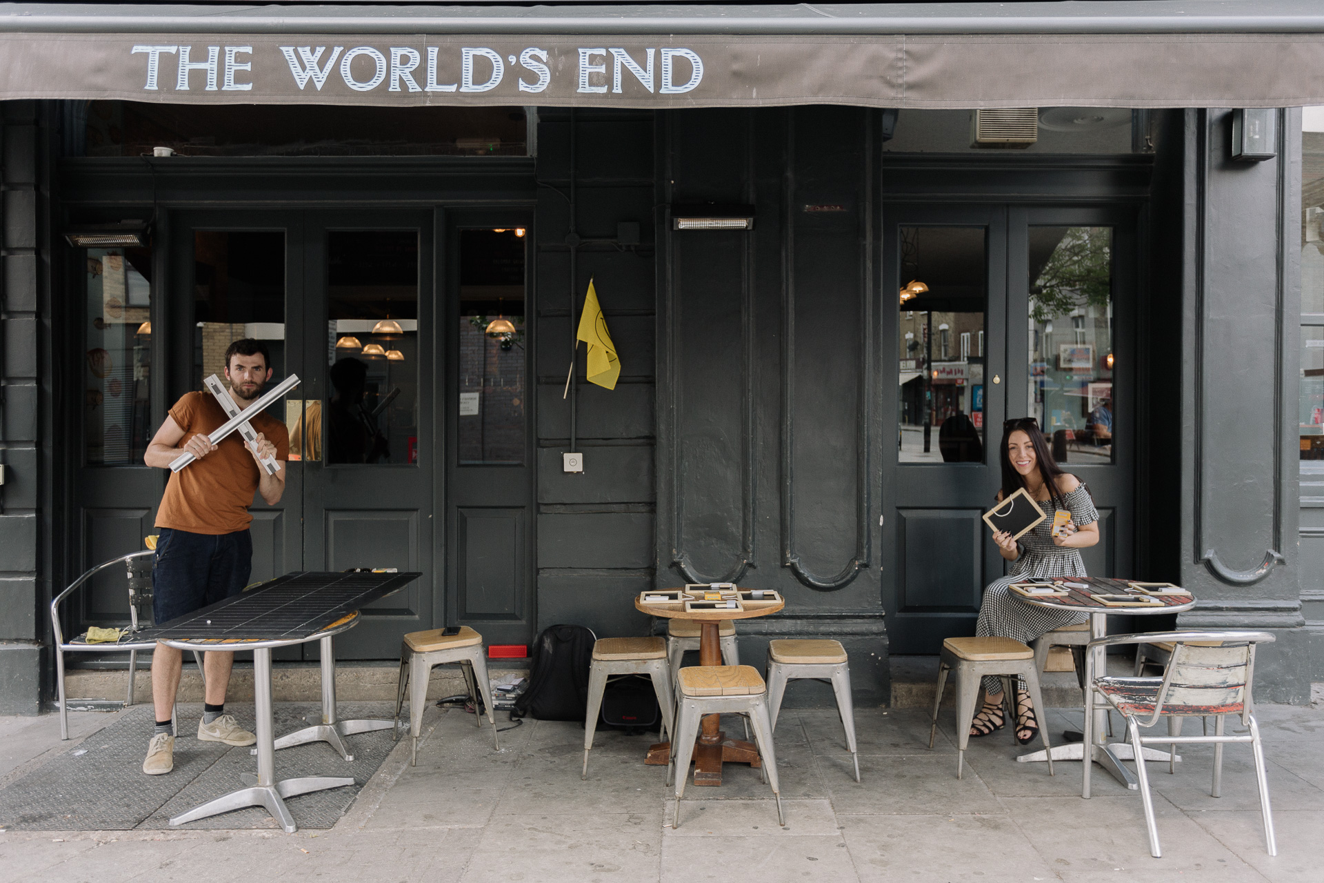 Two people outside The World's End Pub in Stroud Green.