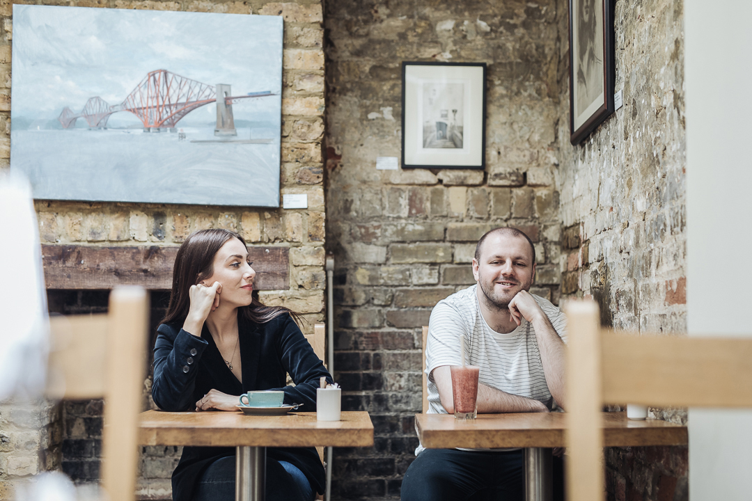 Claire, owner of locally based brand design and creative studio Barefaced Studios with her co-worker in a local cafe in Stroud Green.
