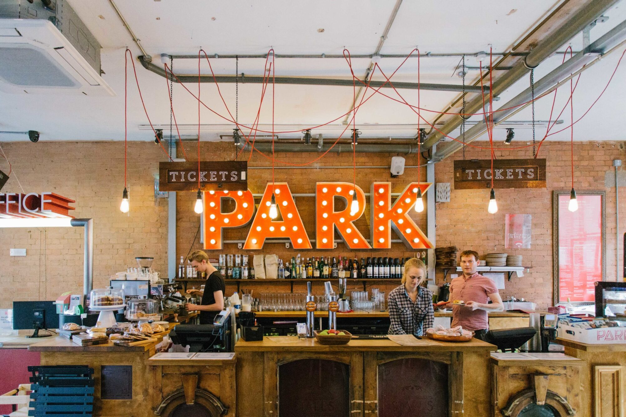 People working in the cafe at The Park Theatre in Stroud Green.