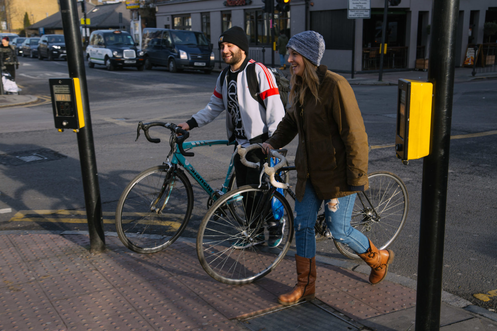 A couple cycling through Stroud Green in North London