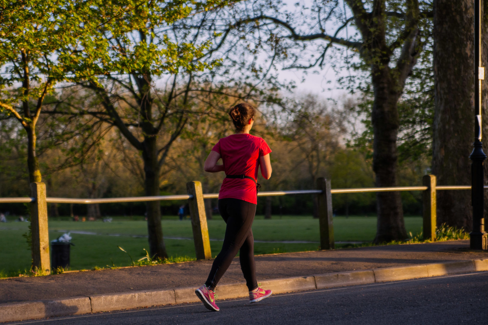 A woman running in a green space in North London