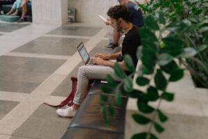 A man on his laptop gathering sorting through digital files