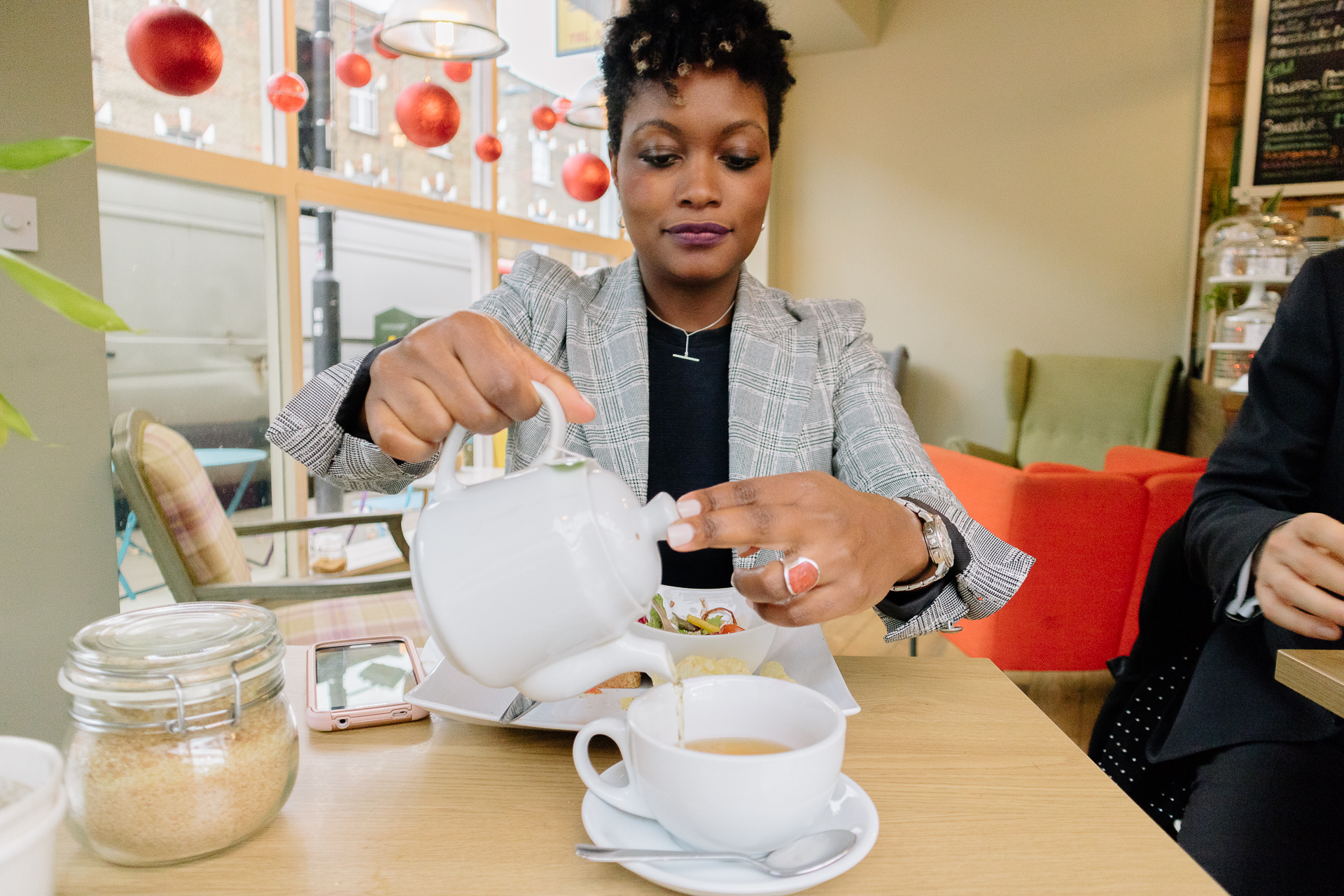A Davies & Davies employee pouring coffee in a local cafe.