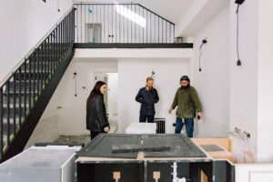 The team at Davies & Davies reviewing work being done in a property.