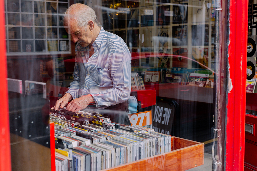 A man looking through records in a local record store in Crouch End.
