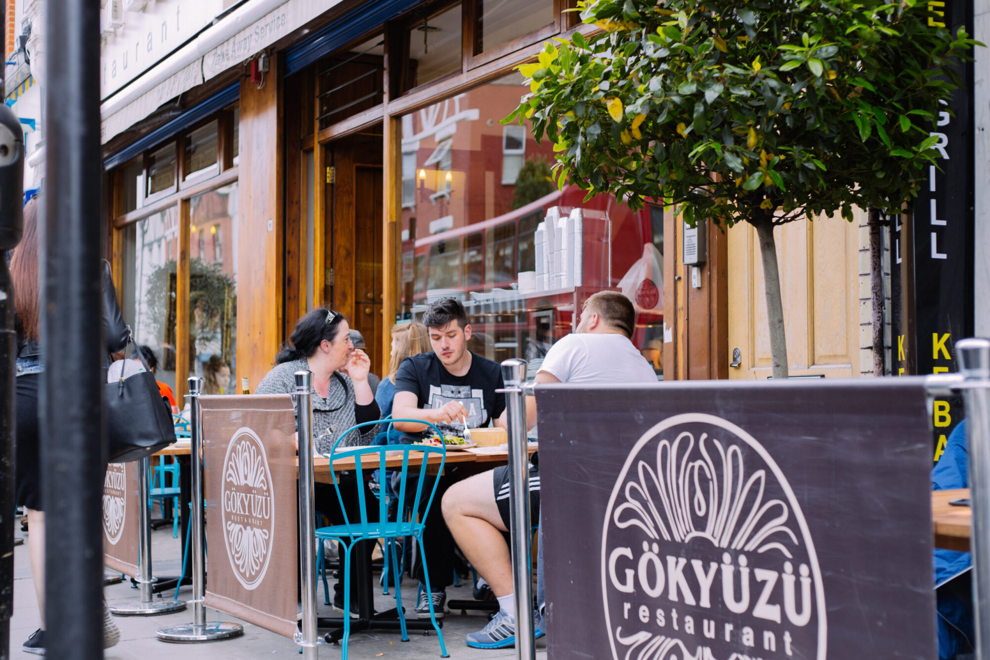 People eating in the outside area of Gokyuzu, a Turkish restaurant in Harringay.