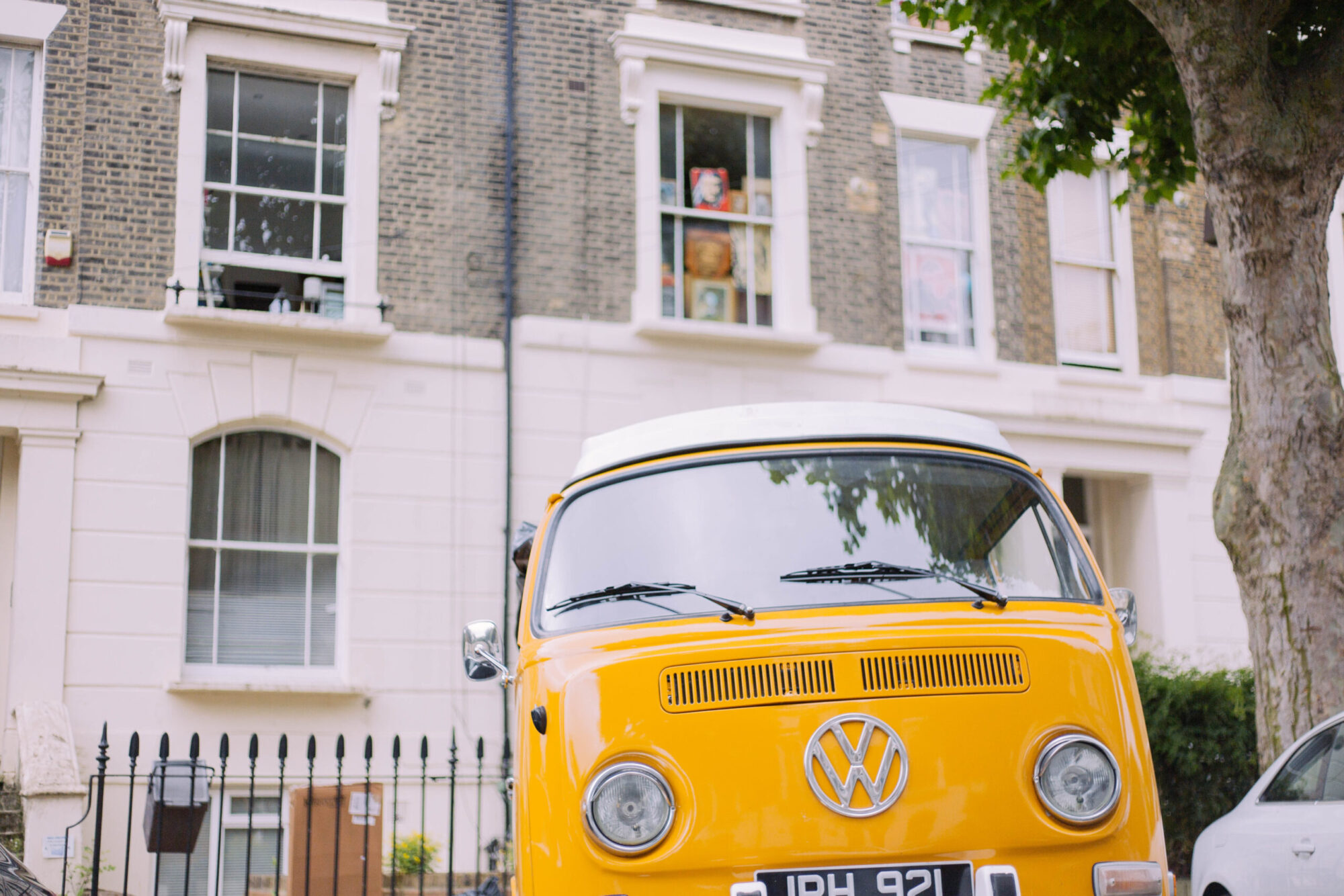 A yellow campervan on a residential road in Holloway.