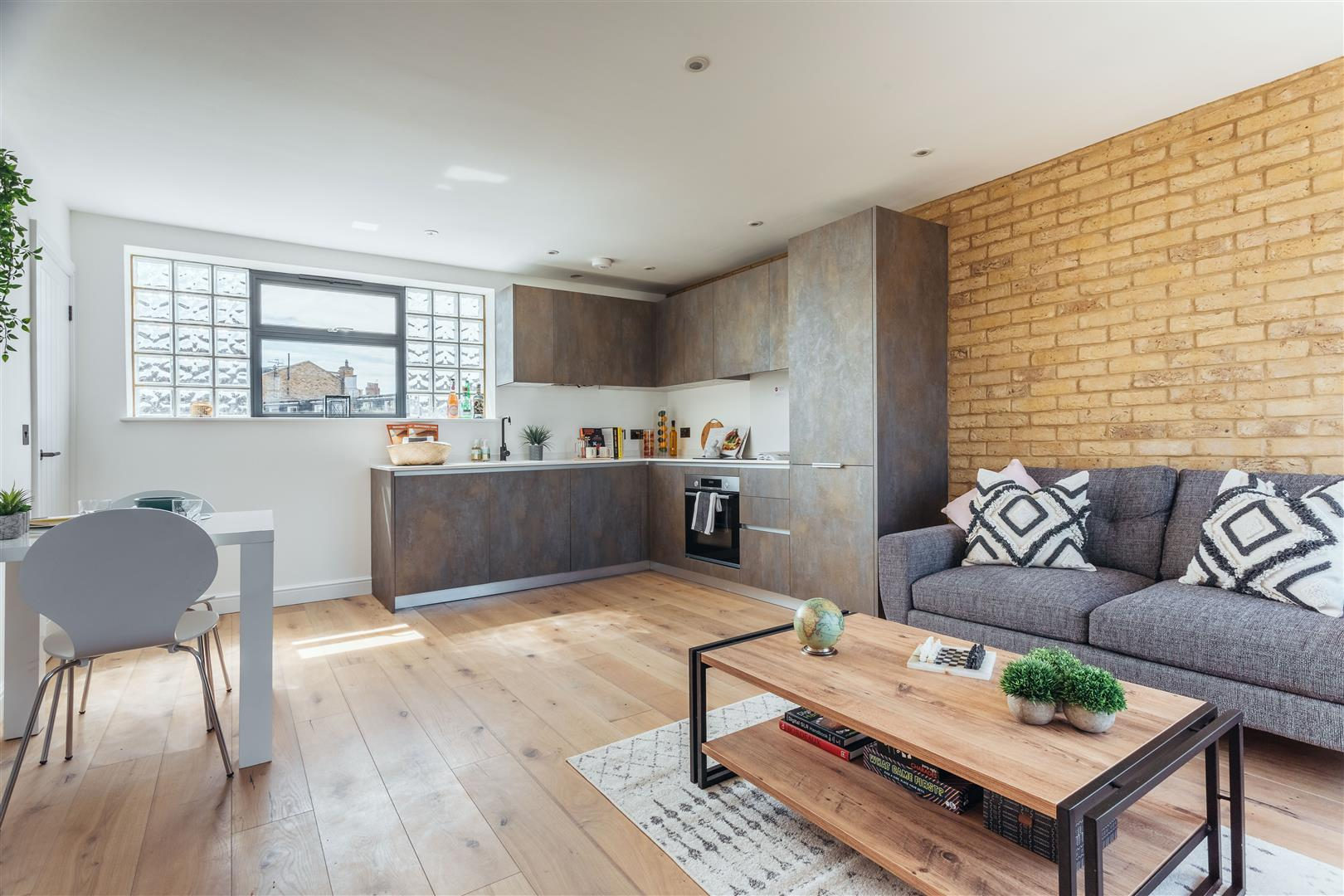 The Living Room of a 1 Bed Maisonette Currently For Sale in the Creatively Imagined Ironworks Yard, Sold by Davies & Davies Estate Agents.