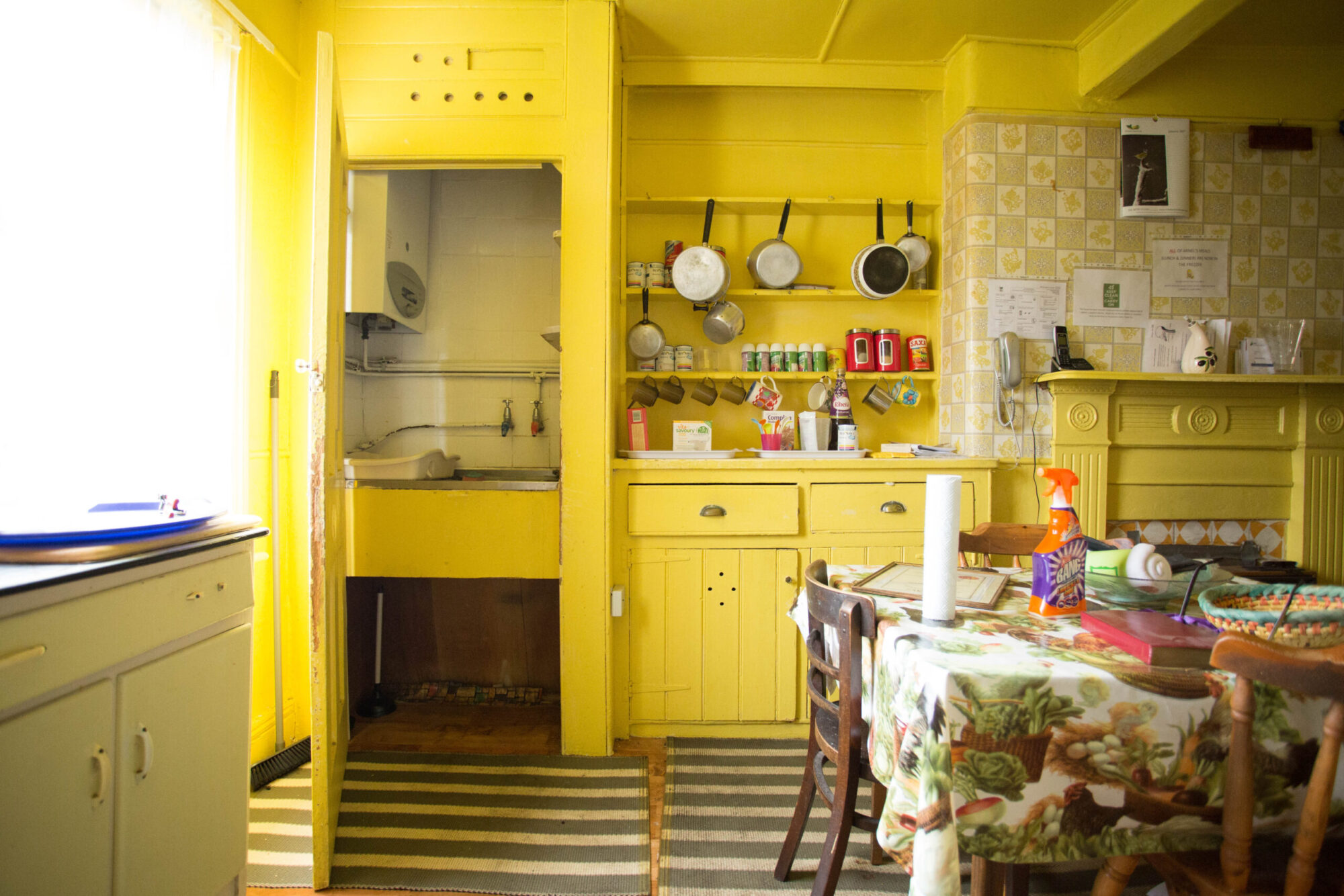 A photo of a kitchen in an old property in need of renovation.