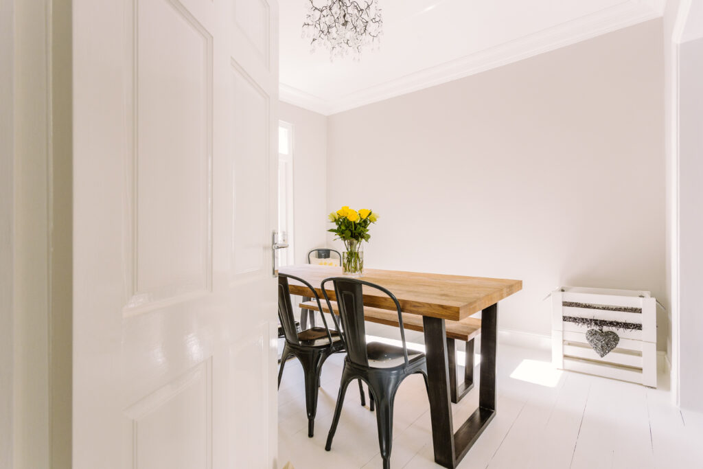 A photo of dining room that's appearance is spotlessly clean - everything is perfectly placed like a show home.