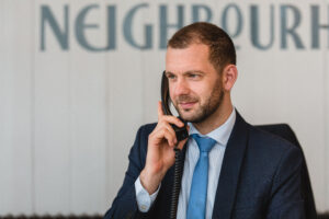 Photo of a member of Davies & Davies team calling a Landlord to confirm they rental property has new tenants.