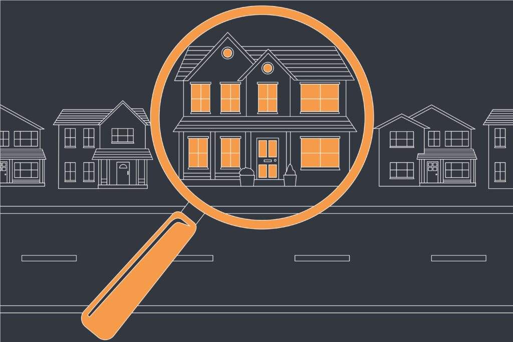 A illustration of house seen using a magnify glass that makes it stand out from all the rest on the street.